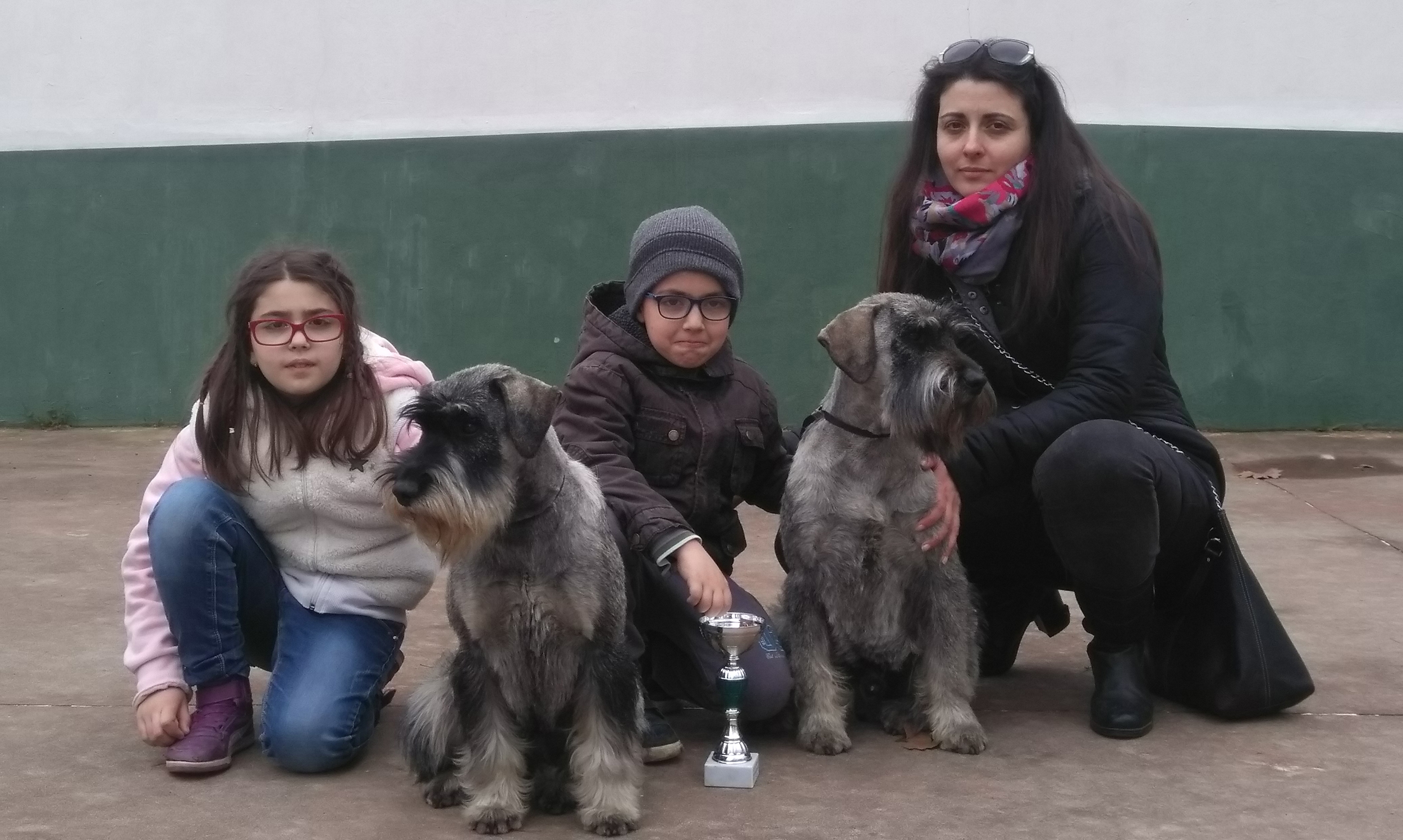 Family photo mother, children and schnauzer